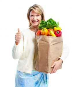 11454805 - senior woman with a grocery shopping bag.